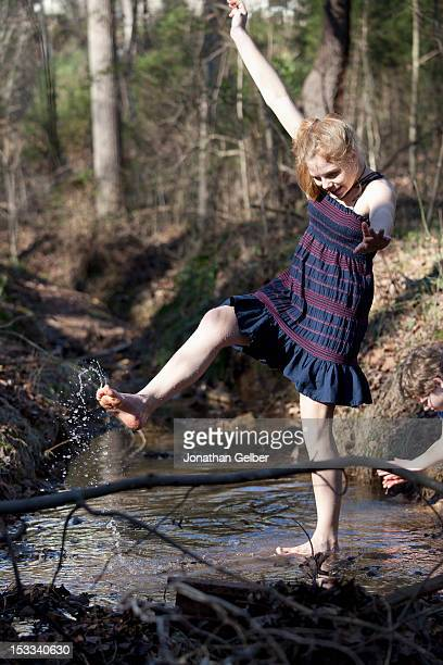 girl kicking her feet through the water in mooresville, north carolina, usa - barefoot redhead stock photos and pictures