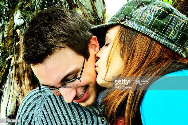 Girl Kisses Boy Under Apple Tree (Xpro)