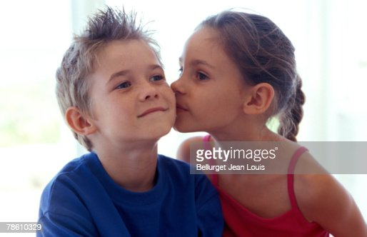 Girl Kissing Boy On Cheek Stock Photo - Getty Images-2749