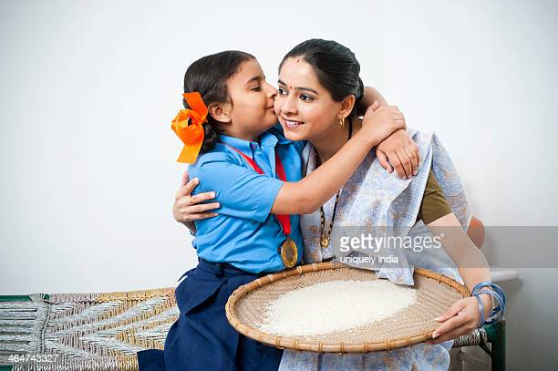 girl kissing her mother - indian girl kissing stock photos and pictures