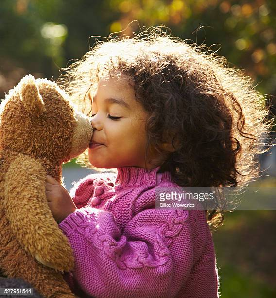 girl (2-3) kissing teddy bear - teddy bear stock pictures, royalty-free photos & images