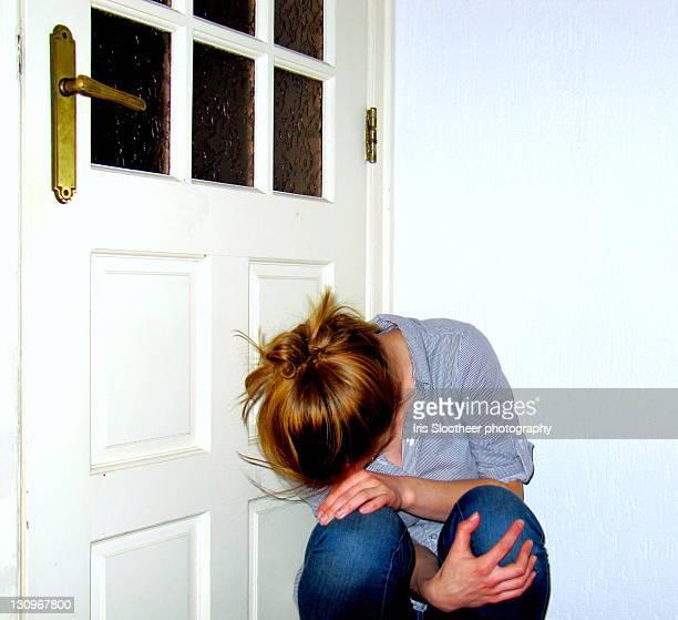 Girl kneeling before door