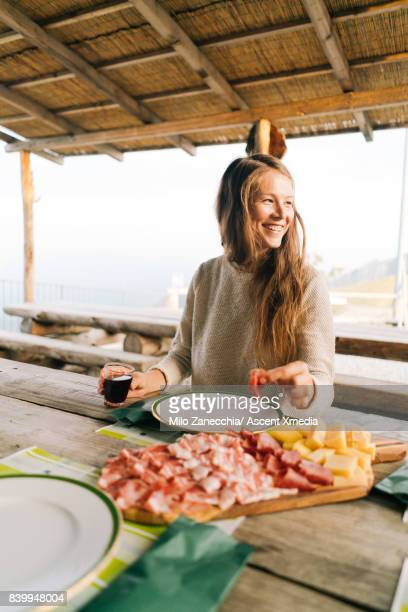 Girl laughing at dining table