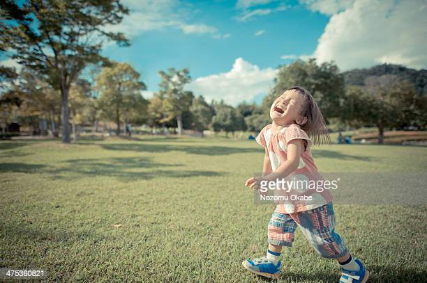 girl laughing at the park