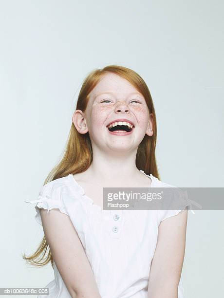 girl (8-9) laughing, close-up - bambine femmine foto e immagini stock