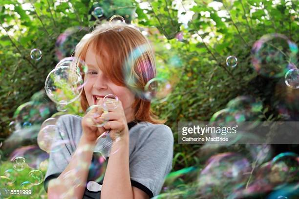 Girl laughing surronded by bubbles