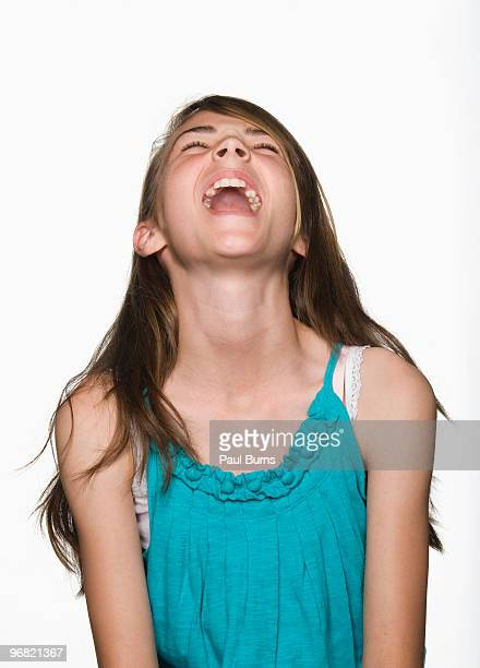 Girl laughing with head tilted back