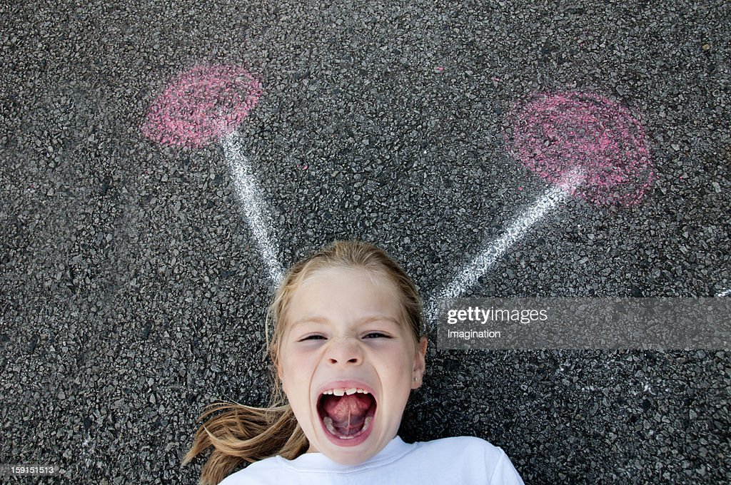 Girl laughing with magic hard band : Stock Photo