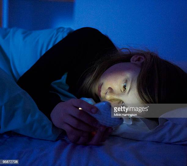 girl laying in bed. - la plagne stock photos and pictures