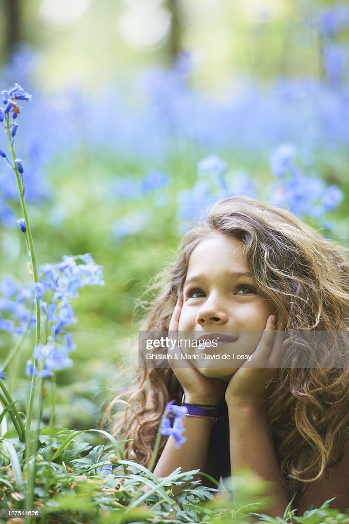 Girl Laying In Field Of Flowers High-Res Stock Photo ...