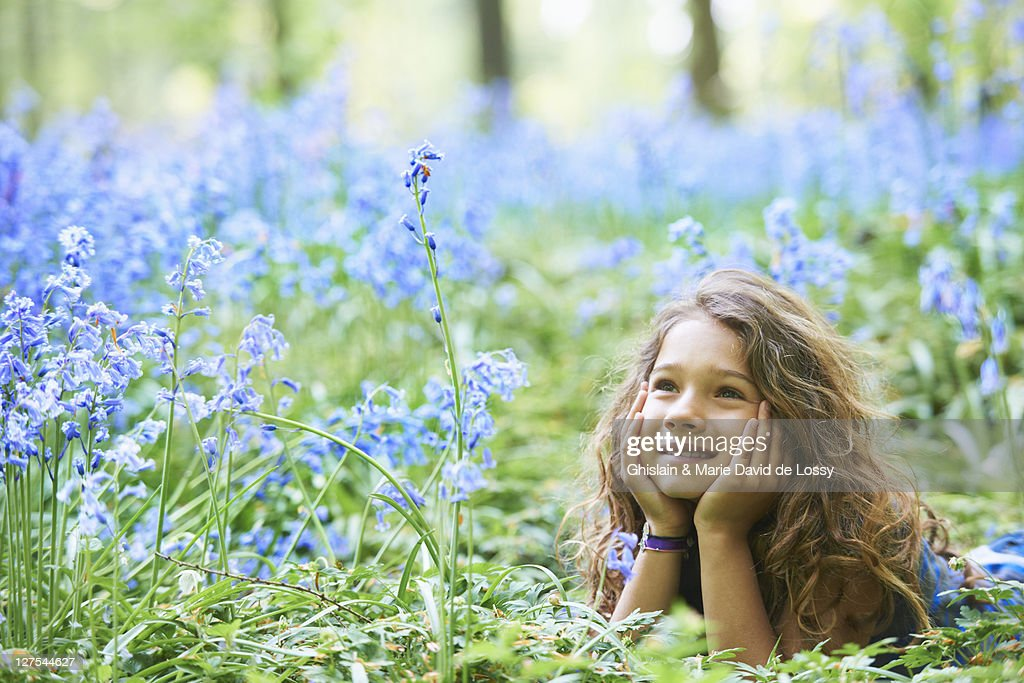 Girl Laying In Field Of Flowers Stock Photo - Getty Images