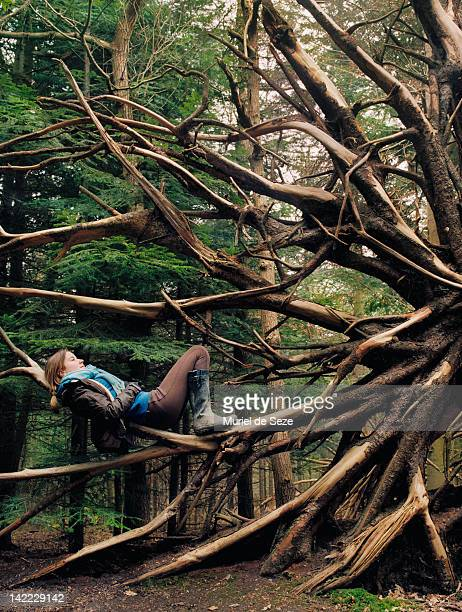 Girl laying on tree root