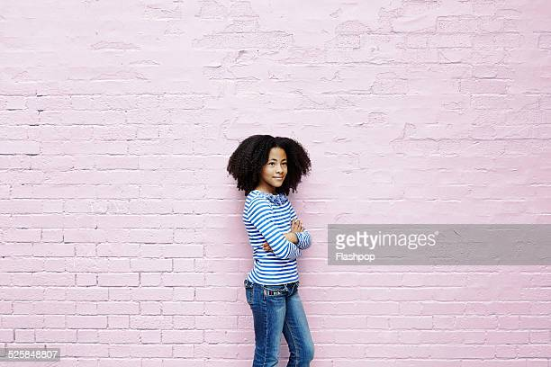 girl leaning against wall - one girl only stock pictures, royalty-free photos & images