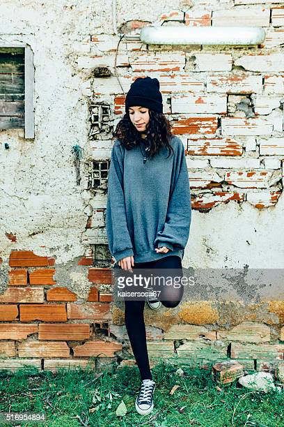 Girl leaning at wall