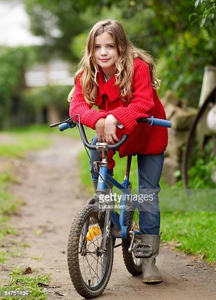 Girl leaning forward on her bicycle handlebars