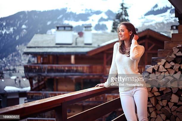 Girl leaning on Balcony in Swiss Alps