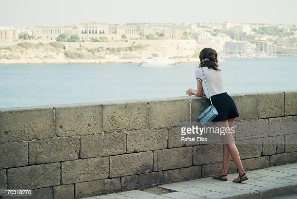 Girl leaning on breakwater