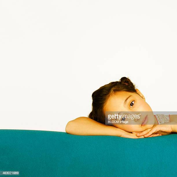 Girl Leaning On Sofa