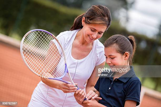 Girl learning tennis