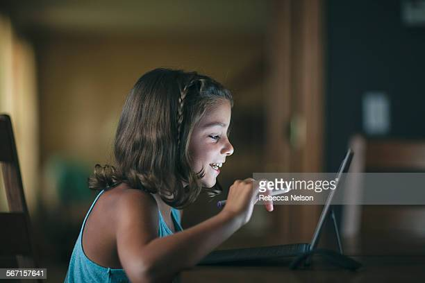 girl learning to code on a next generation tablet