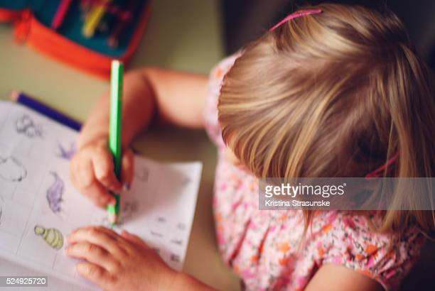 girl learning to color - colouring book stock photos and pictures