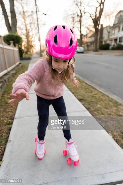 girl learning to rollerskate - montclair stockfoto's en -beelden