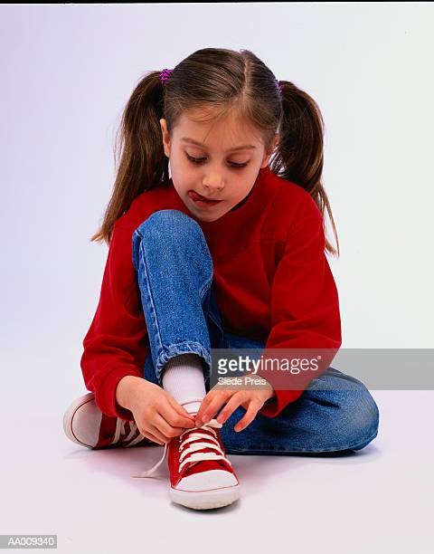 Girl Learning to Tie Her Shoe