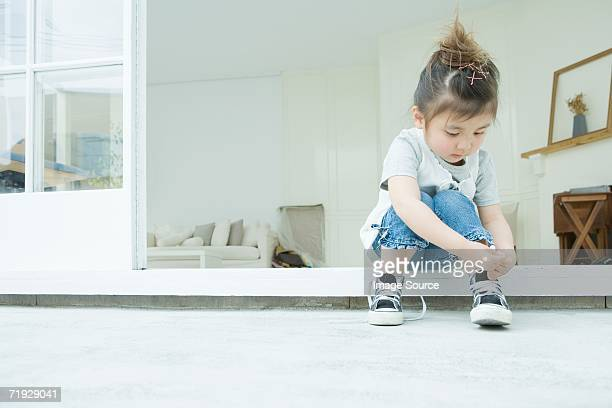 girl learning to tie her shoelaces - tie stock pictures, royalty-free photos & images