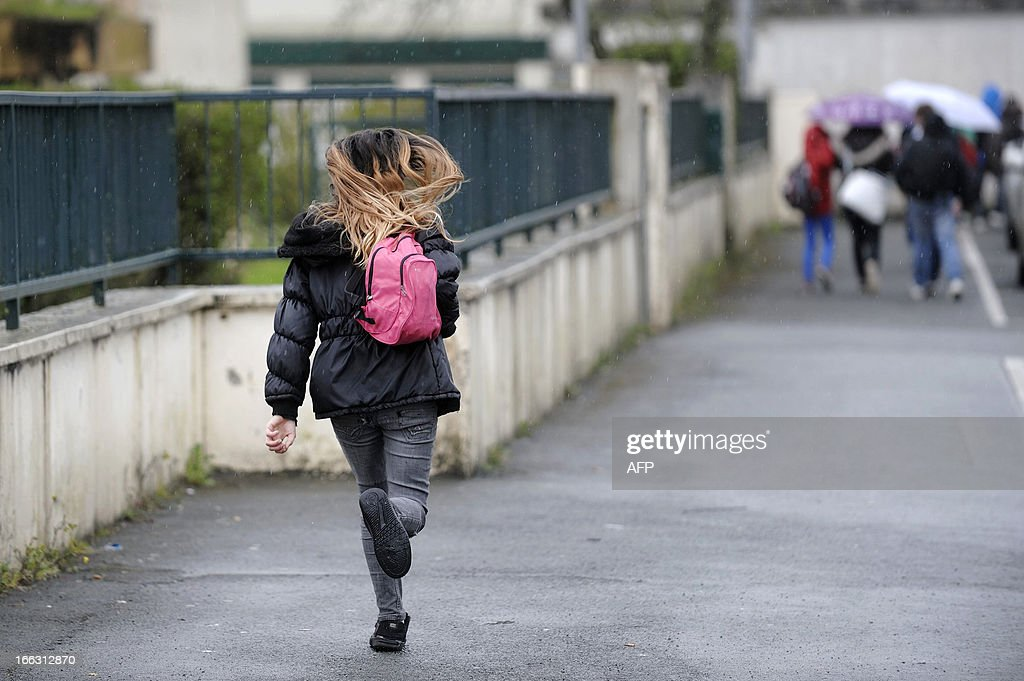 A girl leaves after class on April 11, 2013 the Rene Couzinet college where an eleven years old girl was kidnapped after school and released a few hours later on April 10 2013 in Chantonnay, western France. A man was quickly arrested by the Fench gendarmes and confessed the crime according to the prosecutor of La Roche-sur-Yon.