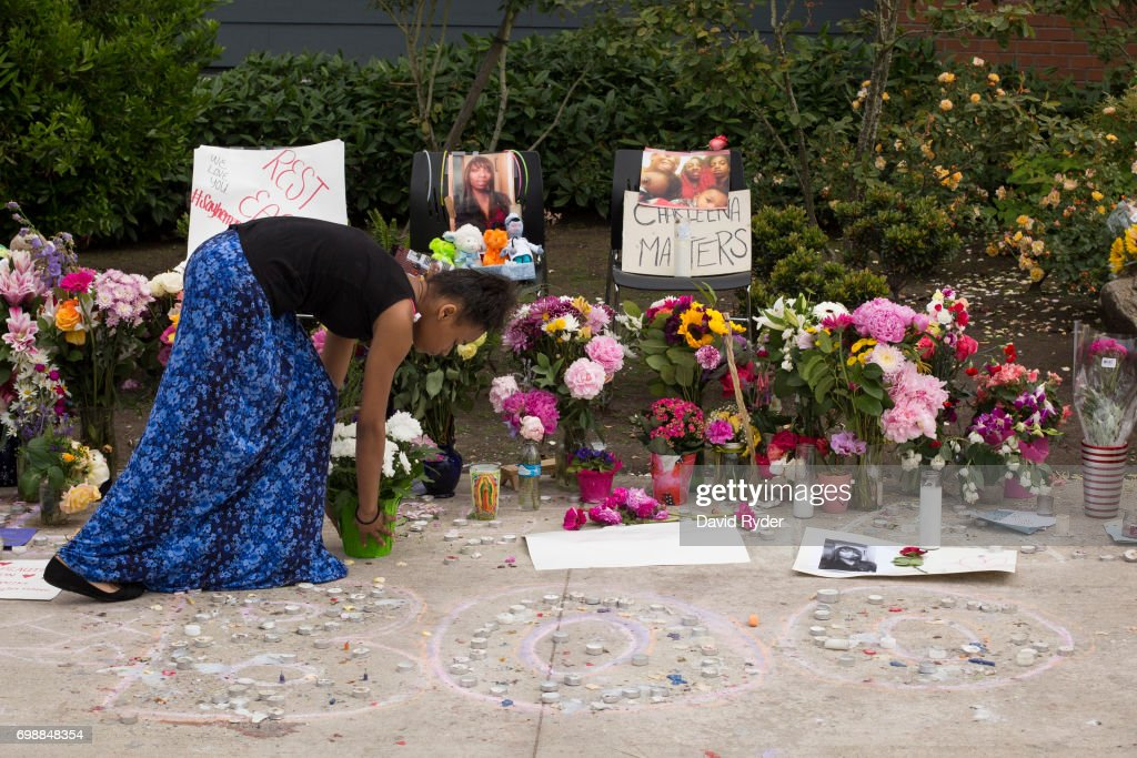 A girl leaves flowers at a memorial for Charleena Lyles at the apartment building in which she was killed on June 20, 2017 in Seattle, Washington. Officers from the Seattle Police Department shot and killed Lyles, a pregnant mother of four, on June 18.
