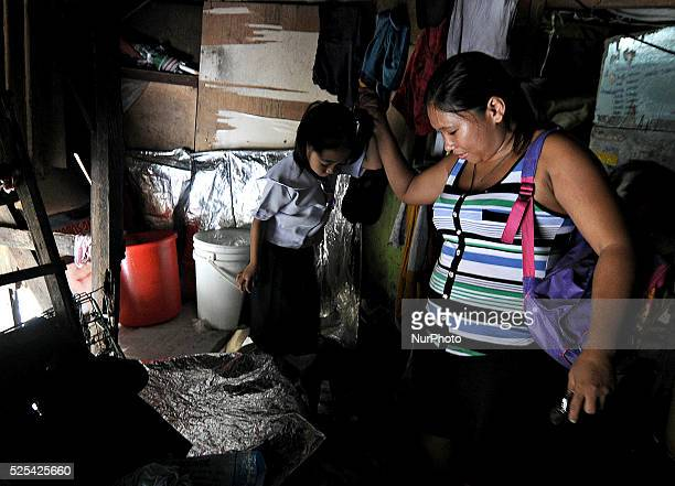 A girl leaves for school inside their makeshift home under a busy bridge in Quezon city suburban Manila Philippines July 30 2013 Photo Ezra...