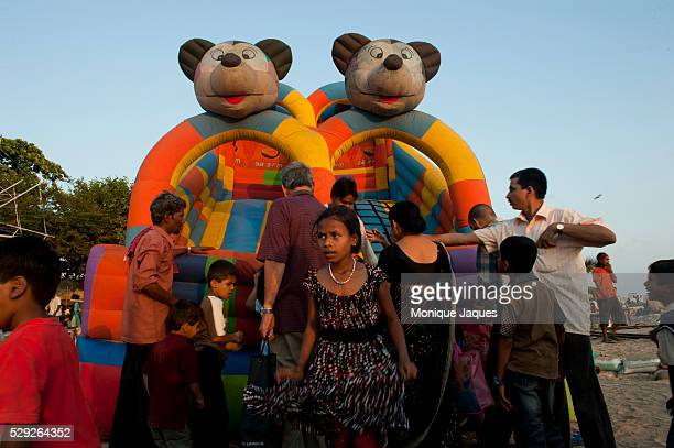 A girl leaves the blowup slide at Chowpatty Beach Locals and tourists visit Chaowpatty Beach in Mumbai Traditionally the site of the yearly Ganesh...