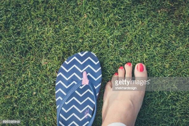 Girl legs on green grass