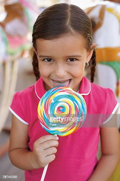 Girl Licking a Giant Lollipop