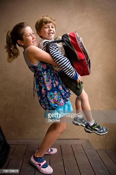 girl lifting her little brother