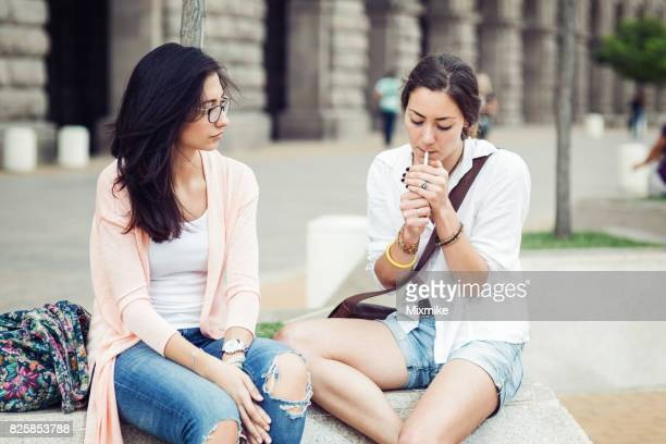 girl lighting up a cigarette - little girl smoking cigarette stock photos and pictures