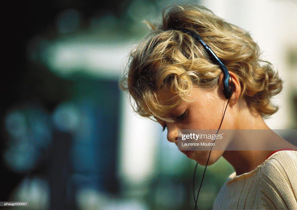 Girl listening to headphones : Stock Photo