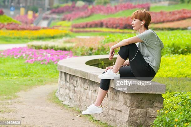 Girl listening to music by earphones