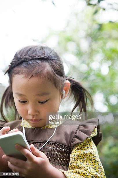 Girl listening to music on smartphone