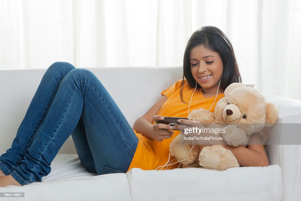 Girl listening to music : Stock Photo