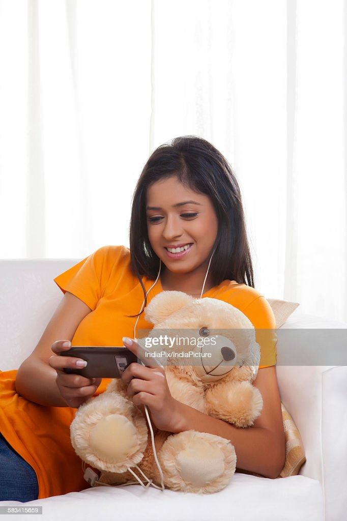 Girl listening to music : Stock Photo