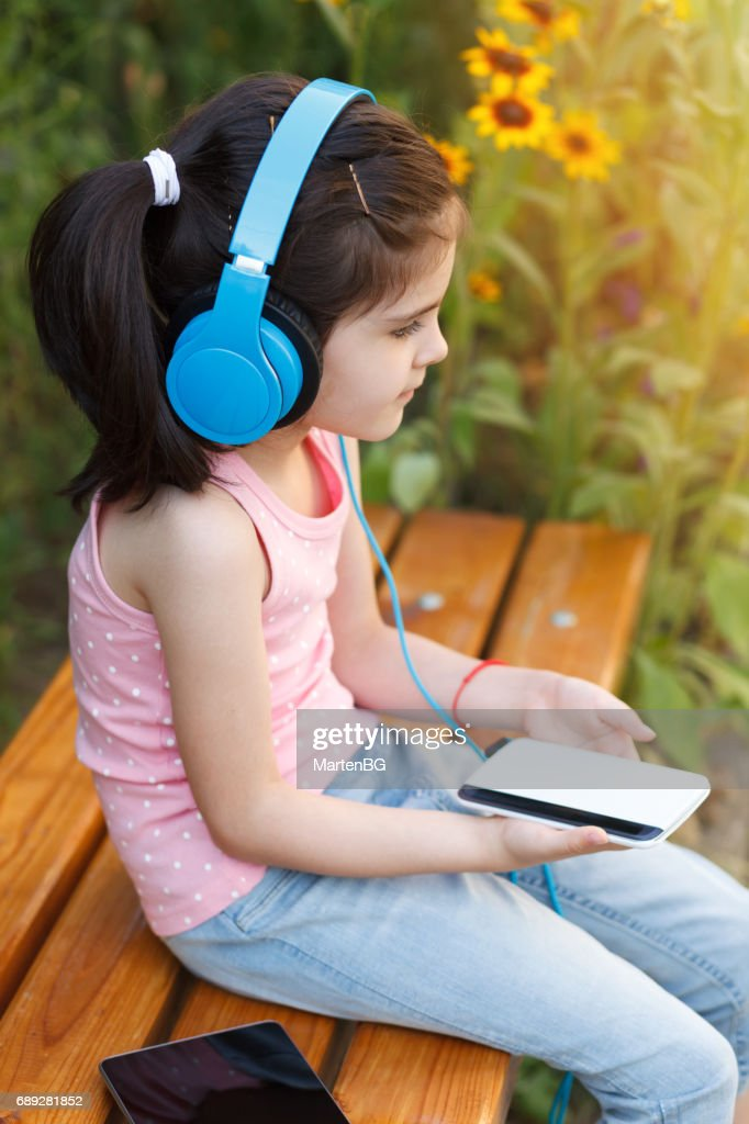 Girl Listening To Music With Headphones : Stock Photo