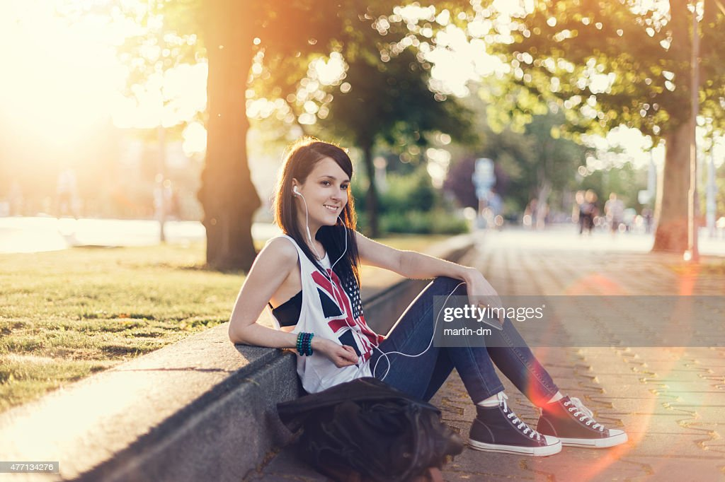 Girl listening to the music from smartphone : Stock Photo