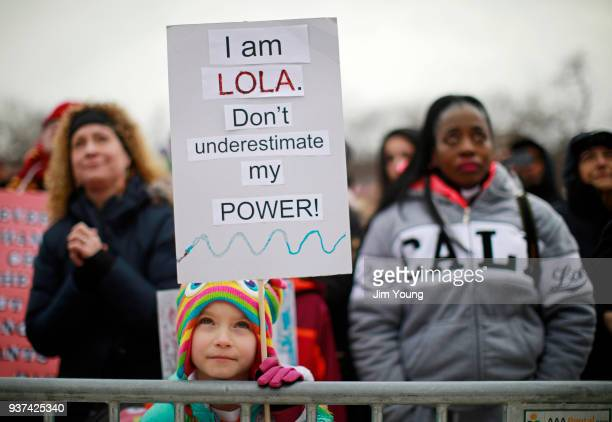 A girl listens to remarks during the March for Our Lives rally on March 24 2018 in Chicago Illinois More than 800 March for Our Lives events...