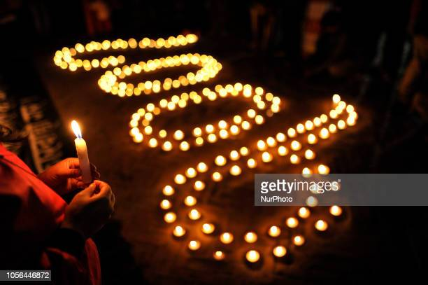 A Girl lit a candle lights on the memory of Nirmala Panta in 100th day at the premises of Krishna Mandir Patan Nepal on Friday November 02 2018 Over...