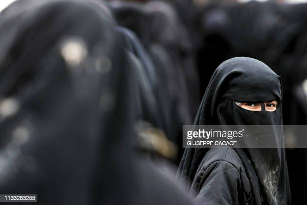 TOPSHOT A girl living in alHol camp which houses relatives of Islamic State group members looks back in the camp in alHasakeh governorate in...