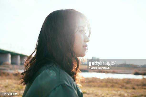 girl looking at a distance - 静かな情景 ストックフォトと画像
