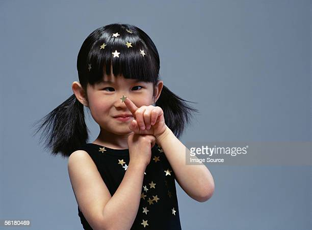 girl looking at a gold star - cross eyed stock pictures, royalty-free photos & images