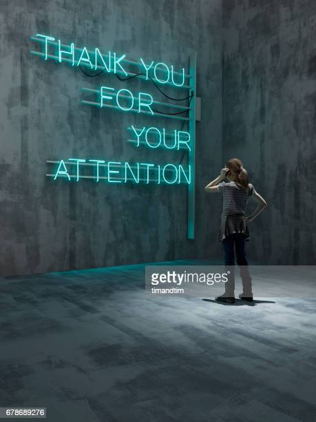 girl looking at a neon - neon letters stock photos and pictures