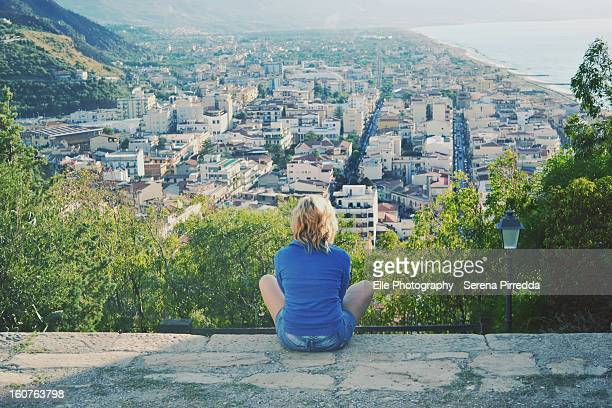 Girl looking at a panorama from the top of a hill